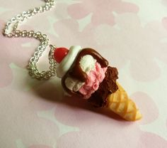 ice cream cone pendant is hand crafted from polymer clay and comes on an 18 silver chain~  the pendant is around 1 1/2    CUSTOMIZABLE!  want