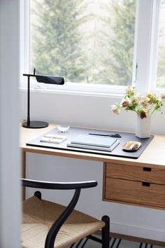 Kamel simplified the office space down to a few beautifully designed basics, including a Hedge House Furniture desk and a sleek FLOS Lighting task lamp   archdigest.com