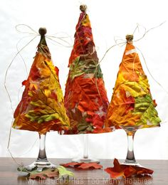 DIY Leaf Tree Luminaries.. leaves, wax paper, modge podge, wine glasses, battery operated tea lights!
