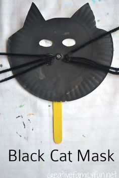 Make a simple black cat mask from a paper plate. It's a fun Halloween craft for kids.