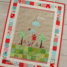 This little quilt is adorable. Look at the quilted clouds! ~ by nanaCompany via Flickr