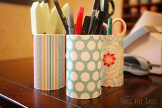 Scrapbook paper covering paper pencil holders. $3 total for 6 containers.