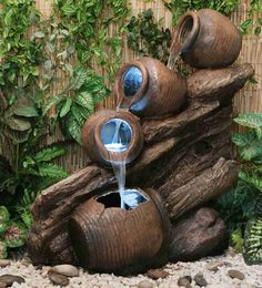 Four Tier Oil Jar Cascade Water Feature with Lights. Featuring four oil jars, this beautiful water feature has been wonderfully crafted out of high quality polyresin to create this lovely and realistic product.