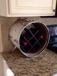 Repurposed tabletop drum wine rack by MusicAsArtBySarah on Etsy