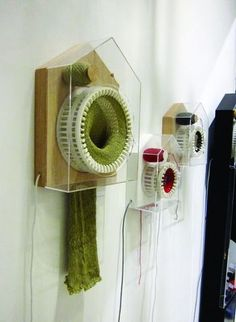 This is one of the most amazing things I have seen! Brilliant. A clock that knits a scarf every year!