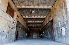 The inside of an abandoned Atlas E complex, where the nuke was stored on its belly. In preparation to launch, the sliding roof retracted and the missile was rotated 90-degrees on its crib structure. The Air Force established 27 Atlas E missile sites (3 squadrons of nine missile sites each in Kansas, Wyoming, and Washington) along with two test sites at Vandenberg AFB.