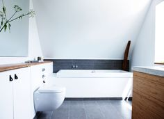 The narrow cabinets that are flush with the wall for the wall-mounted toilet handle storage for all the little things that you typically have in a bathroom. The table top of the cistern and the cabinets are of bamboo Terrazzo, Narrow Cabinet, Diy Crafts For Home Decor, Wall Mounted Toilet, Living Room Interior, Bathroom Interior, Living Rooms, Bathroom Inspiration, Bathroom Ideas