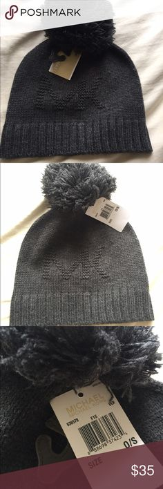 Grey Michael Kors beanie hat with pom pom NWT Michael Kors dark grey winter  hat with fuzzy pom pom. MK initials on the hat. Was a gift but I have too  many ... 289f0f16e01f