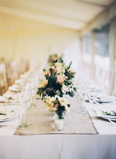 long reception table // photo by David Jenkins Photography, flowers by Fiona Perry // View more: http://ruffledblog.com/english-fusion-wedding/