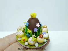 Dollhouse miniature Easter tray with Easter egg and cupcakes.  Etsy.