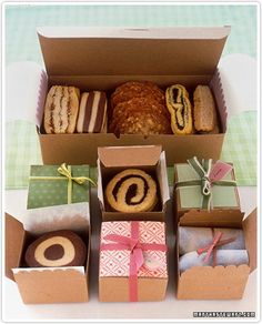 cookie packaging ideas Box with bow, greenery, little animal at top of stocking