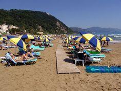 Glyfada Beach near Corfu Town Corfu Beaches, Travel Around The World, Around The Worlds, Corfu Town, Corfu Greece, Beach Tops, Greek Islands, Planet Earth, Outdoor Gear