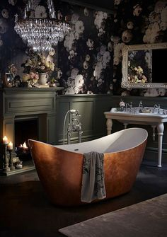 Add some interest to your vintage bathroom with dark floral wallpaper. This dark bathroom design creates such a luxurious appearance and matches perfectly with that amazing freestanding bath! Winter bathroom goals!   . #wholesaledomestic #bathroomdecor #bathrooms #bathroomdecorating #bathroominspiration #bathroominterior #bathroominteriordesign #dreambathrooms #vintagebathrooms #luxurybathrooms #bathroomdecorideas #bathroomdesign