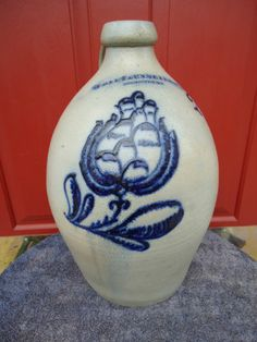 14.5in tall. F. Stetzenmeyer, Rochester, New York 2g Stoneware Jug with Elaborate Floral