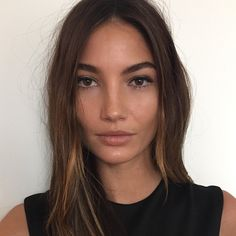 A less is more, undone makeup. Dewy skin and a thin liquid liner.