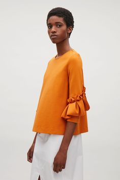 COS image 7 of Top with frill detailed sleeves in Orange