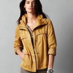 "Ann Taylor Loft jacket . PM Editor + Host pick A modern camel / gold twill anorak with feminine details in soft twill. Wide collar with tonal drawstring tie for optional ruching. Drawstring at the bottom hem. Ruched at bust seams, 3 slit pockets. Tonal drawstring at waist for optional ruching. Inverted pleat at back. 23"" centerback length. 41% Cotton, 41% Polyester, 18% Nylon. Great condition. Host pick by @vaughnal, @sijolie71 and @profoundtruths Best in Sweaters, Jackets & Coats…"