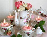 Floating rose candles in tea cups tablescape