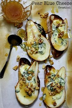 Pear and Blue Cheese Crostini, with walnuts and a drizzle of honey.