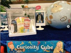 Curiosity cubes are a great way to promote curiosity, communication, investigation and discussion within an early years setting. Sign up to Twinkl to download our Curiosity Cube Display Pack.   #curiositycube #cube #curiosity #display #ice #winter #teacher #teach #eyfs #earlyyears #classroom #teach #twinkl #twinklresources Communication And Language Eyfs, Communication Activities, Eyfs Activities, Nursery Activities, Curiosity Approach Eyfs, Investigation Area, Curiosity Box, Science Display, Discovery Box