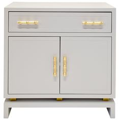 "The Worlds Away Marcus cabinet captivates with a modern Palm Beach vibe. Striking gold leaf hardware with a bamboo motif highlights the lacquered furnishing's functional yet stylish appeal. Two doors open to reveal concealed storage. 29""W x 18""D x 29""H; <li>Available in Gray & Gold Leaf, Navy & Gold Leaf, and White & Gold Leaf</li>; Gold leaf bamboo hardware; Two doors and one glide drawer"