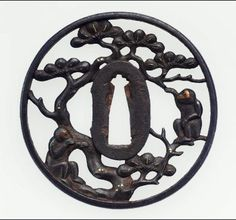 Tsuba with Monkeys in a Pine Tree Openwork Design. Edo Period, Circa Mid to Late 17th Century.