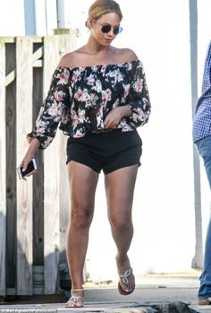 Pretty as a petal: Beyonce put her best foot forward on Saturday as she stepped out in the Hamptons sporting a stylish, off-the-shoulder floral blouse