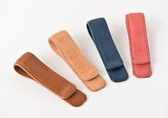 These leather clips are constructed with natural Italian leather and clip over the edge of your Weeks book. The clips are useful for attaching papers or memo books to your book in addition to carrying a slim pen within the curved edge as it holds your page for quick reference. The clips have been sized to fit the Weeks on any edge, be it the top, bottom, or side. The clip is also handy for using with an A6 Original/English or A5 Cousin book. The clip comes in navy, rose, caramel, and tan...
