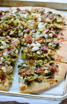 Brussels sprouts caramelized with balsamic vinegar, crispy bacon, feta cheese, and mozzarella create a savory and delicious pizza!