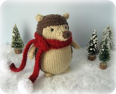 Hand knitted cute hedgehog in a red scarf. Seems this little dude feels quite warm! =)