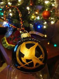 Hunger Games Christmas Ornament need to do that Office Christmas Decorations, Christmas Games, Great Christmas Gifts, Holiday Fun, Christmas Holidays, Christmas Crafts, Christmas Ornaments, Diy Ornaments, Happy Holidays
