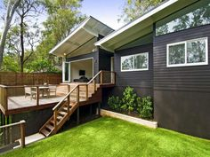 deck against choc-brown house with white trim.
