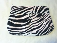 Pleated Zebra Print Makeup Bag with Pink by BriesBagsAndMore, $10.00.  This is one of the cute, trendy makeup bags that my 14 year old daughter Brie offers on her ETSY account - Bries Bags and More.  She and I are adding sewing accessories, children's smocks, and some lovely aprons to the shop.  Everything cute and handmade....not too early to think Christmas!  Check out BriesBagsAndMore!  Thanks!