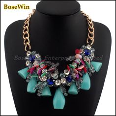 Chunky Gold Chain with Clear Crystal Flowers and turquoise coloured resin beads. Also available in  coral/pink and black
