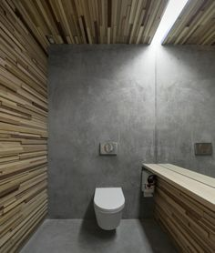 Using microcement and concrete in the bathroom is stylish and practical. Béton ciré Microcement FESTFLOOR Life is completely waterproof, so it can be used in shower cabins Bathroom Concrete Floor, Concrete Wood, Polished Concrete, Concrete Floors, Cement Walls, Bathroom Interior, Modern Bathroom, Small Bathroom, Bathroom With Wood Wall