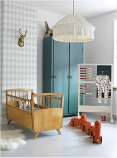 Beautiful mid century style cot plus lovely airforce blue colour scheme for a boy