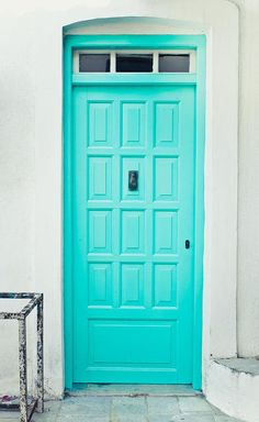 Turquoise front door in Greece. - Photograph by Tom Gowanlock