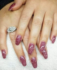 Dusty rose pink glitter gel nails in a rounded coffin shape