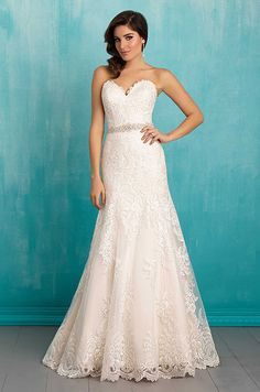 This A-line gown features scalloped lace at the sweetheart neck and hemline. See photos of Allure Bridal's Spring 2016 wedding dress collection.