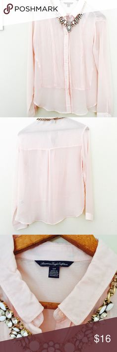 AE Blush Pink Blouse This sheer pink blouse is delicate and soft. It has a cotton like panel in the front and the rest is a sheer blouse material. Has a collar and buttons all the way down! In very good condition just found I wasn't wearing it as much as I would like! American Eagle Outfitters Tops Blouses