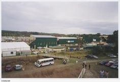 Taken behind the main stands (in green and silver) with some action captured between the parking area and the racetracks at Oakbank Races, 10 April 2004.