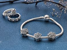 Midnight blue goes excellent with shining sterling silver jewelry pieces. Perfect for your New Year´s outfit! #PANDORA #PANDORAbracelet #PANDORAcharm