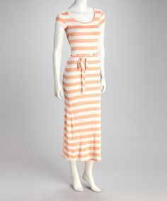 There's a time and place for punchy prints, but sometimes a streamlined stripe makes an equally trendy statement. Stretchy and sleek, this maxi dress features an adjustable tie at the waist for an extra-slimming effect.Measurements (size S): 53'' long from high point of shoulder to hem55% rayon / 41% polyester / 4% spandexMachine wash; tumble dryImported