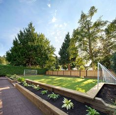 Landscaping Ideas - Liven Up Your Backyard With Some Games // This backyard has a mini soccer field.