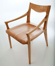 "Sam Chair - Constructed of tiger maple, this chair is named after its inventor and one of my influences, Sam Maloof.  This is my tribute.  It's an updated version of his classic sculpted chair with a subtle touch of my personal style. Measures approximately 20"" wide x 18"" deep x 32"" high."