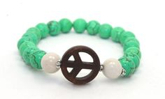 Beautiful Green Magnesite, Fossil Beads and Brown Peace Sign Stretch Bracelet www.ayadesigns.artfire.com
