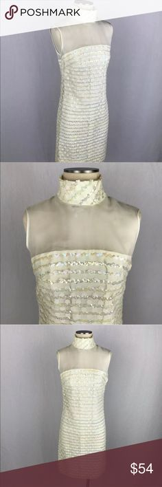 "Vintage Jr. Theme NY Sequin Bodycon Wiggle Dress Vintage ivory wiggle dress! High neckline with multiple clasp closure on the back. Sheer material on shoulders and upper chest. Sequins design in between faint polka dots. Inside is a smooth thin vinyl feeling material. Excellent condition. Tag says size 15. Looks like S/M Chest: 17"" Waist: 17"" Top to bottom: 38"" Vintage Dresses Midi"