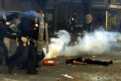 Reuters Riot police storm past a dead protestor who was shot and killed by Carabiniere during rioting in central Genoa July 20, 2001 to protest the G-8 summit held there.