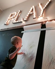 Drawing on a chalkboard wall in a home playroom