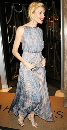 Sienna Miller wears a pale blue and pink printed Valentino gown with metallic sandals